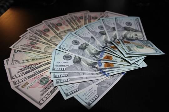 Названо необходимое для счастья количество денег