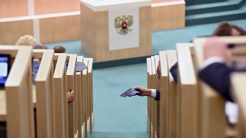 Шесть минут на поправку // Госдума приняла очередной пакет конституционных законопроектов