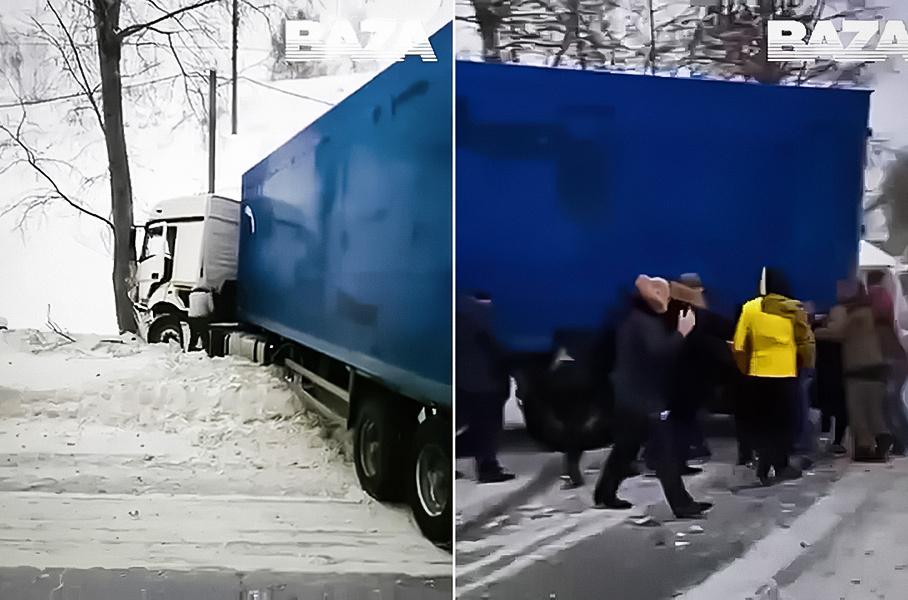 В Сибири водители руками передвинули огромную фуру. Она им мешала
